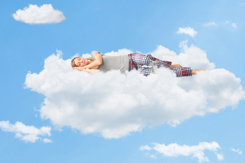 Woman sleeping on cloud